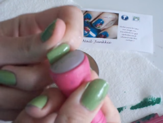 Using a rolling motion, place the design onto the nail