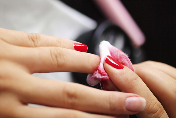 Woman cleaning polish off nails